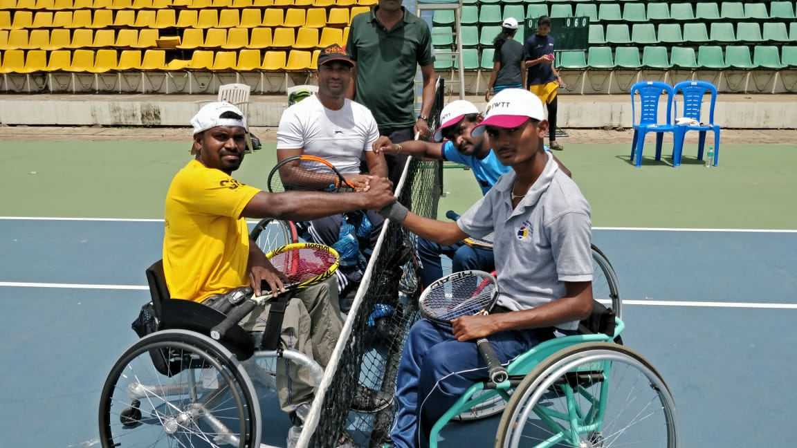 At a polio and children in need charity-sponsored tennis tournament for wheelchair athletes