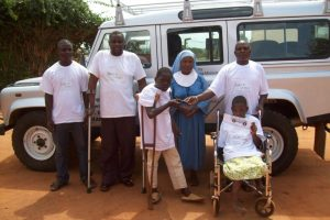 Children and staff with the landrover