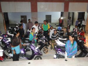 Arun Patel of Polio and Children In Need Charity Co-founder handing over motor scooters to the college bound girls