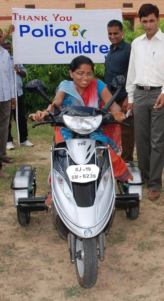 Bintu is thrilled with her new motor scooter