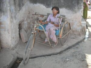 Bintu would hand drive this tricycle 4 km each way from her home to the college