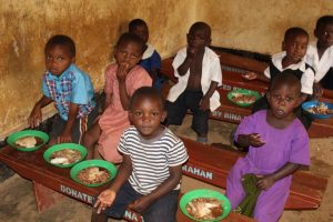 Children having their evening meal in their classroom