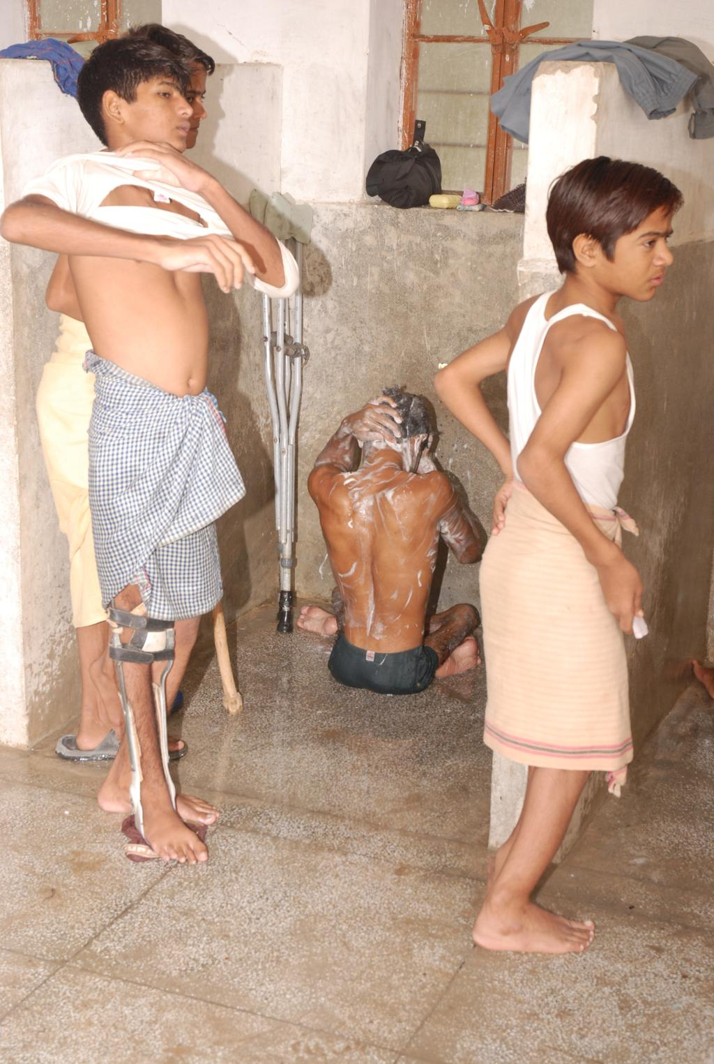 Children performing their morning chores in en suite bathrooms, constructed specifically for the severely disabled