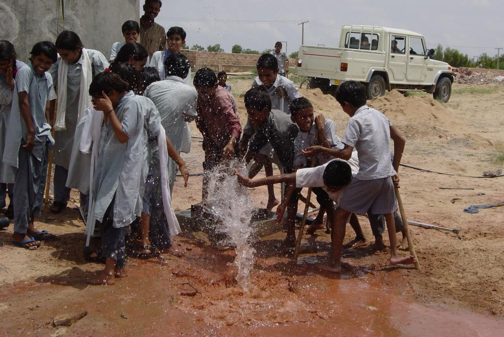 Children-rejoicing-as-water-spurts-from-the-first-ever-bore-well-drilled-on-the-school-campus