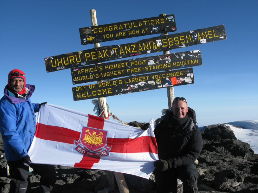 Dip Tanna (Trustee, UK, left) atop Mt. Kilimanjaro which he ascended to raise funds for Polio Children