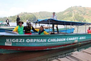 Arun Patel and Mayoor, Patel, PACINC Co-foundesr, and Titus Arinaitwe, Founder, KOCC setting out for a lake ride