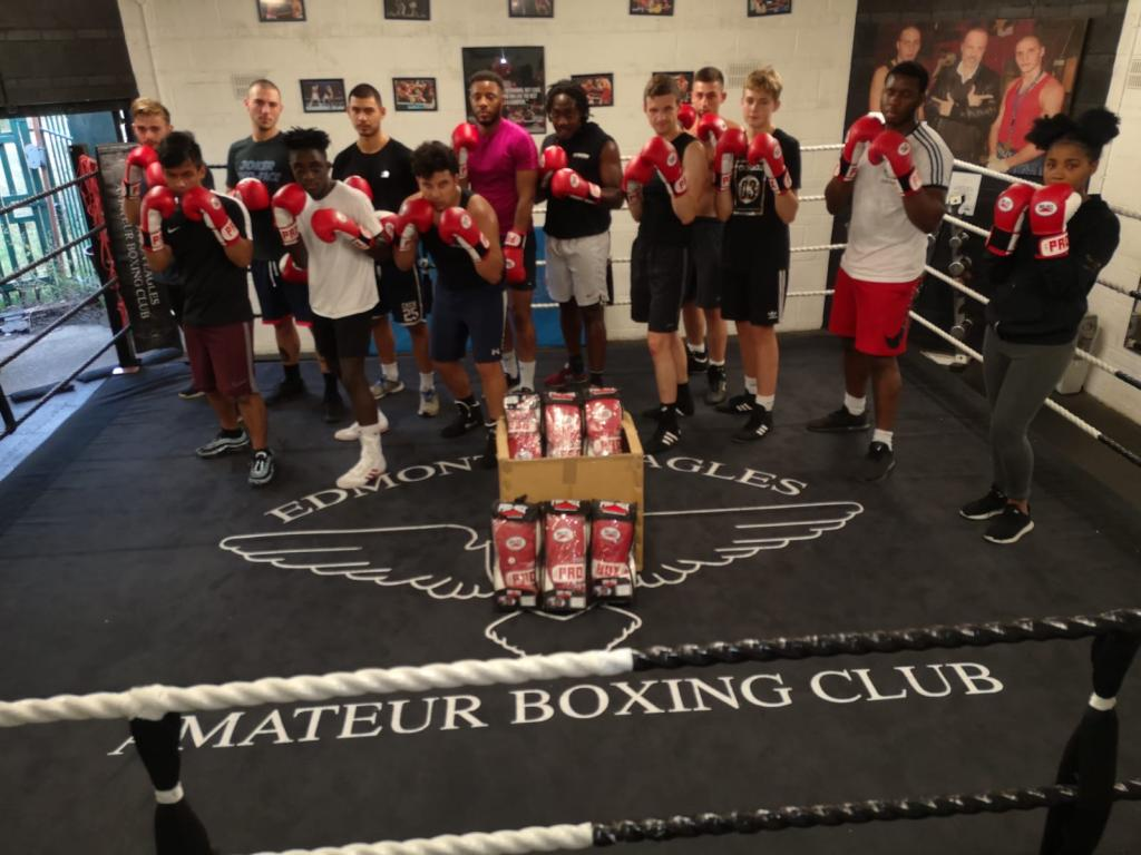 Kids posing in a boxing ring after a class in self-defense