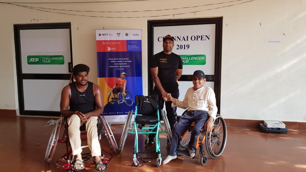 Manoj Soma, Founder, Choice International (standing) donating a wheelchair