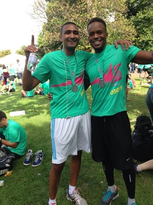 Pankeel (left) and Jermaine (right) pose after a marathon they ran to raise funds for a water project for Kwa Mkono, Tanzania.