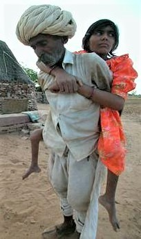 Raj carried by her father
