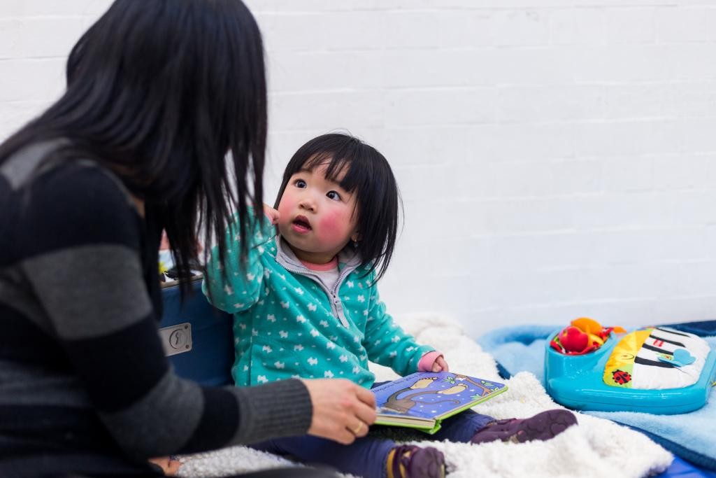 Refugee child's first exposure to a picture book