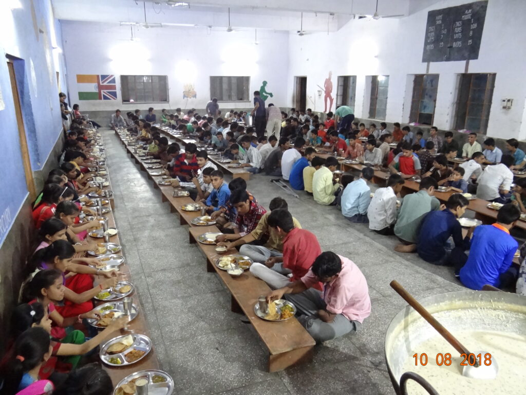 Students in the furnished and refurbished dining hall