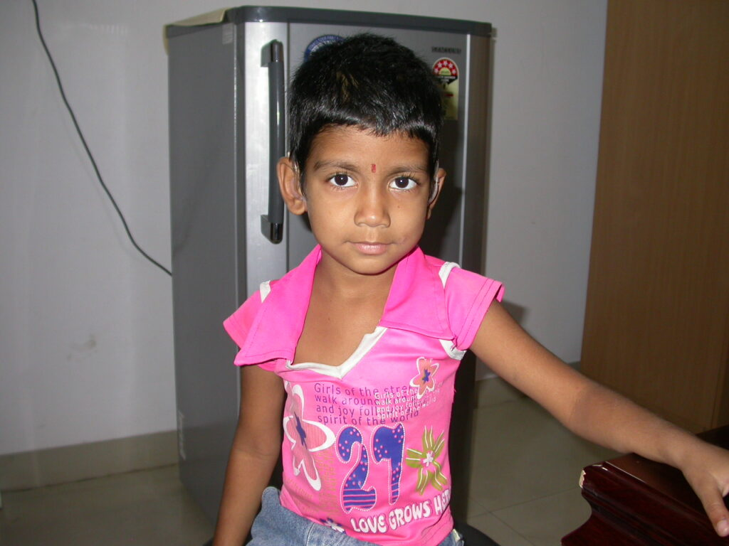 Young girl at a follow-up visit to get hearing checked
