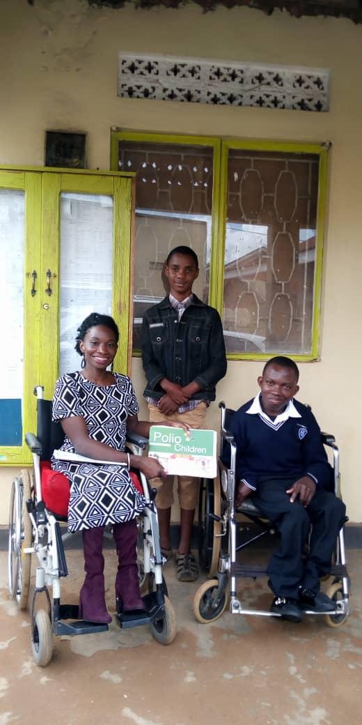 PACINC Tunaweza Victo with two sponsored kids