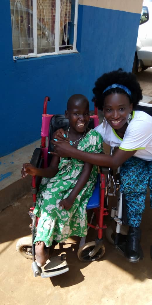 Victo with a disabled girl at an orphanage